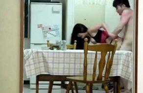 imagen Tailandesa tetona follada en la cocina